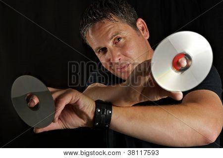 Male DJ Holding CDs