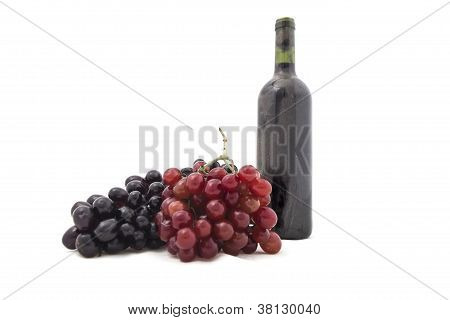 Bunch Of Grapes With A Bottle Of Wine