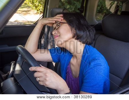 Frustrated Woman In Car In Traffic Jam
