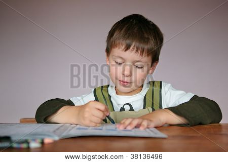 Cute little boy learning to write