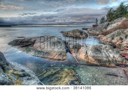 Rocky Shoreline On Grey Morning
