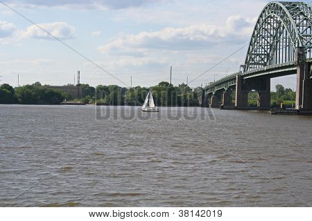 Sailboat Sailing Under a Bridge