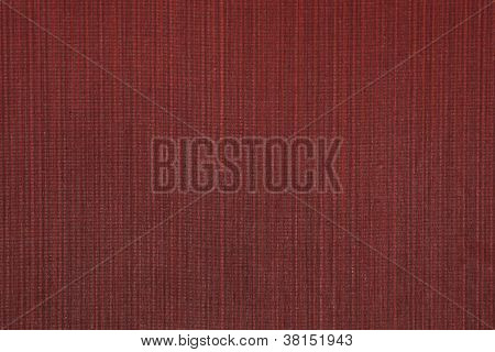 Close-up of red, vertical lined, textile wall fabric background