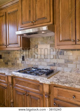 Kitchen Cooktop And Cabinets Angle View