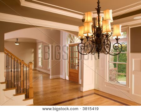 Luxury Home Entranceway With Ornate Hanging Light