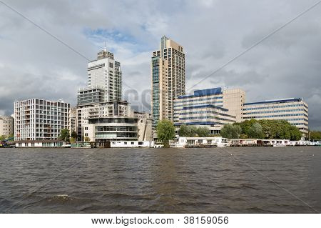 Amsterdam Office Buildings Along The River Amstel In The Netherlands