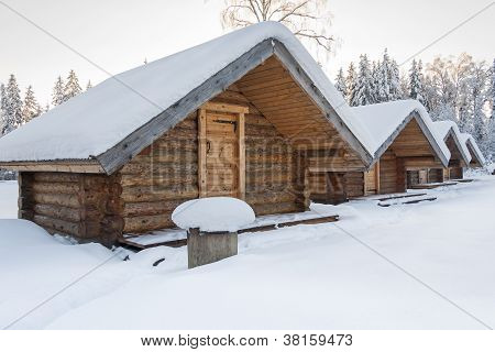 Small Camping Houses At Snowy Winter Day