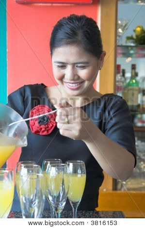 Waitress Making Drink Smiling