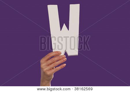 Female Hand Holding Up The Letter W From The Bottom