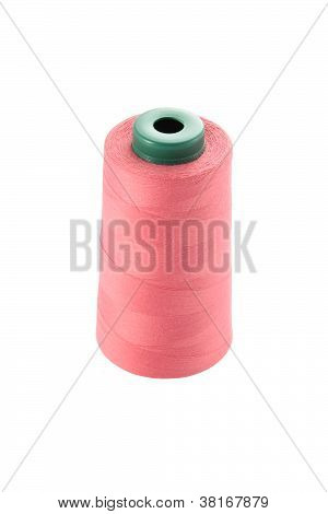 Roll of spun for sewing machine on white background.