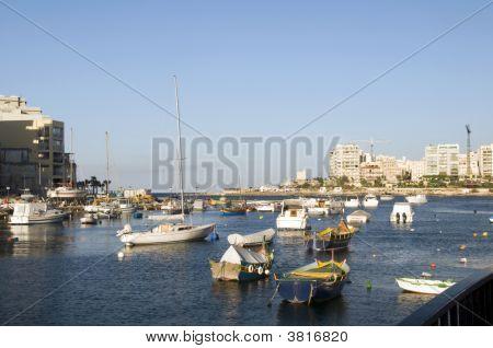 Maltese Luzzu Boat In Harbor St. Julian\'S Malta