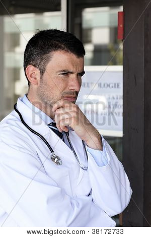 Pensive Doctor At Hospital