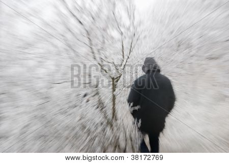 Person in hood in frozen nature