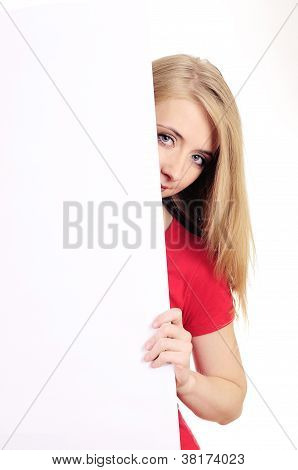 Shy woman looking over blank card