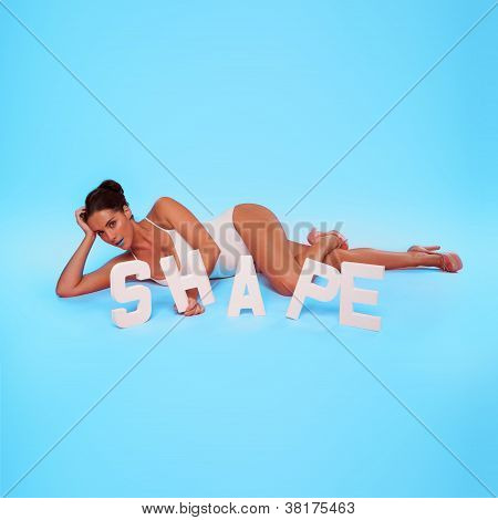 Curvy Woman Posing With The Word Shape