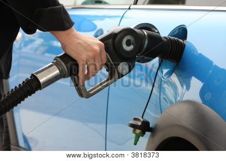 Person Pumping Gass Into Car