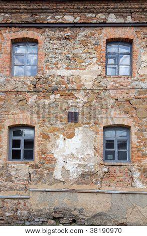 Old Orange Brick Wall With Four Windows