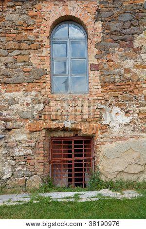 Old Orange Brick Wall With Windows