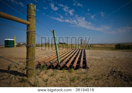 Cattle Guard and Fence Around North Dakota Oil Rig
