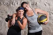 stock photo of boot camp  - Happy boot camp training partners with weight and medicine ball - JPG
