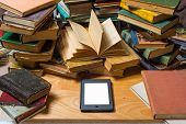 stock photo of untidiness  - Ebook and old books on the table - JPG