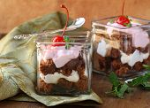 chocolate biscuits with cream , trifle in glasses