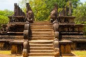 stock photo of polonnaruwa  - Steps and lion carvings lead to the ancient audience hall part of the ruins of the former capitol in Polonnaruwa Sri Lanka - JPG