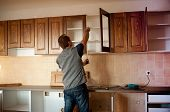 stock photo of carpentry  - Carpenter working on new wooden kitchen cabinets - JPG