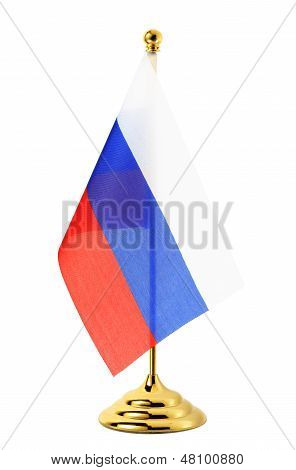Flag Of Russia Hanging On The Gold Flagpole