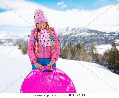 Happy Girl In Pink With Sled