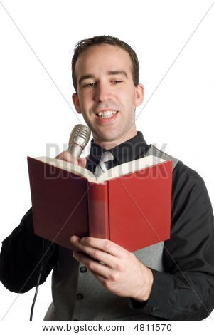 Man Reading Into Microphone