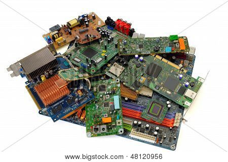 Heap of various electronic circuit boards isolated on white background