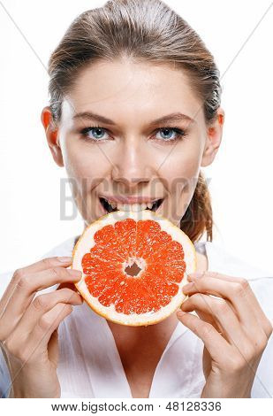 Young beautiful woman eat grapefruit isolated on white background
