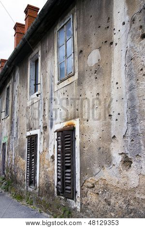 Bullets holes on building after war