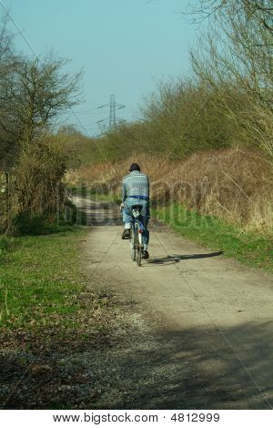 Cycling Along Track