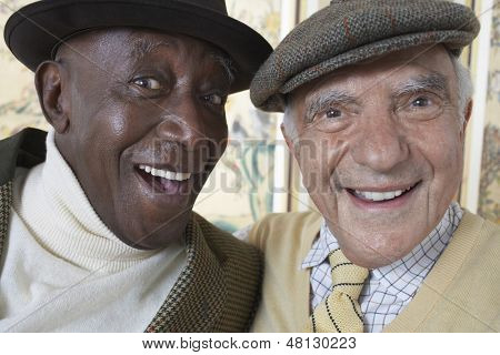 Closeup portrait of cheerful multiethnic senior men smiling