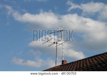 FM radio and vertically polarised television aerials on roof