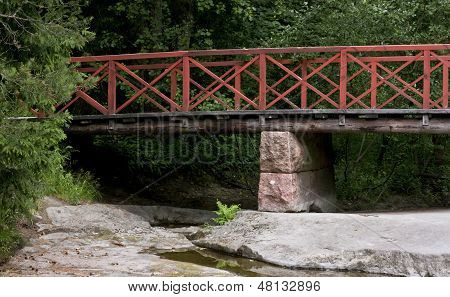 Wooden Bridge Over Dry Forest River