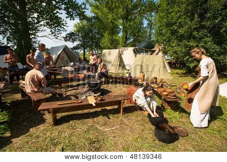 STARAYA LADOGA, RUSSIA - JULY 13: Unidentified participants during of international historical festival of medieval culture Ladogafest-2013 (12-14 of Jul) on July 13, 2013 on Staraya Ladoga, Russia.