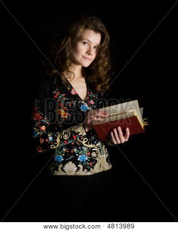 Girl With Book On Black Background