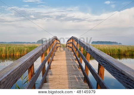 Wooden Bridge Through River