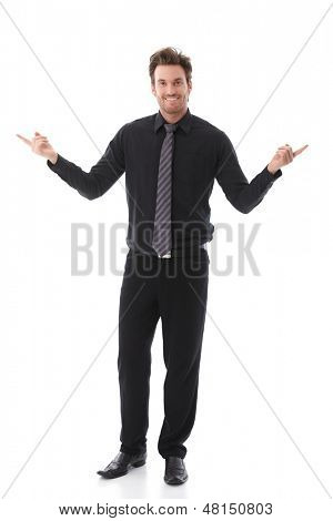 Smiling businessman pointing to left and right sides.