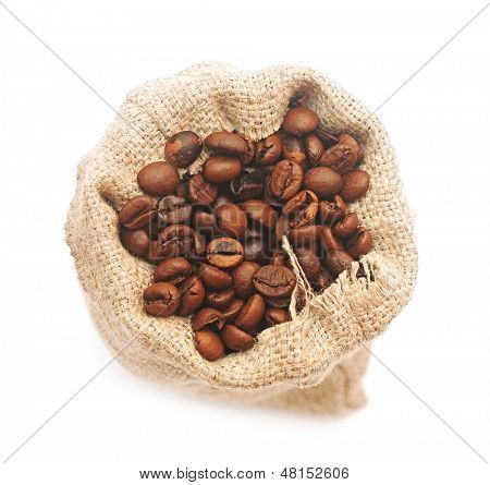 Top view of roasted coffee beans in jute bag
