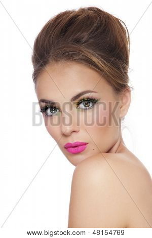 Young beautiful tanned girl with bright fresh make-up over white background