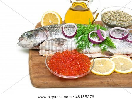 Red Caviar And Fresh Trout On A Cutting Board