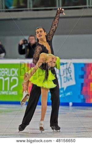 INNSBRUCK, Österreich - Januar 15 Innsbruck, Karina Uzurova und Ilias Ali (Kasachstan) Platz 5. in th