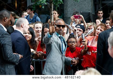 "NEW YORK-JUNE 25: Actor Jamie Foxx signs autographs at  the premiere of ""White House Down"" at the Ziegfeld Theater on June 25, 2013 in New York City."