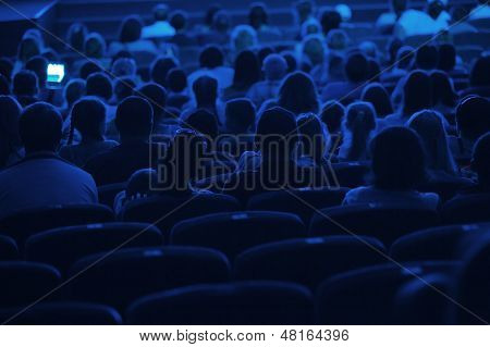 Audience in the cinema. Silhouette.