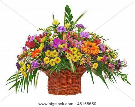 Colorful Flower Bouquet Arrangement Centerpiece In Wicker Basket  Isolated On White Background