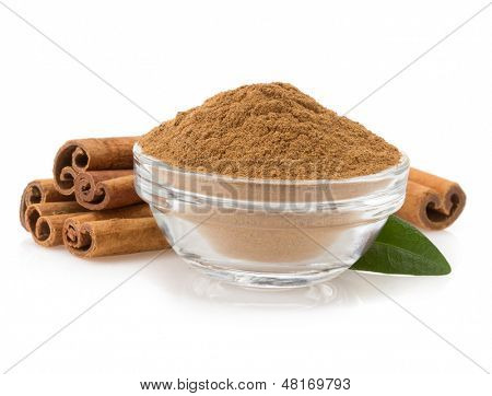 cinnamon in bowl isolated on white background